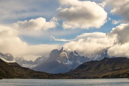 View of the Torres del Paine mountains between the clouds, Torres del Paine National Park, Chile 写真素材