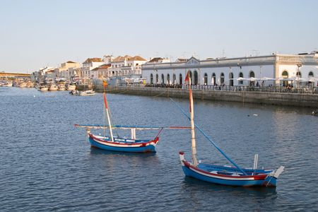 Boats in the sea channel of Tavira, Algarve, Portugal Stock Photo
