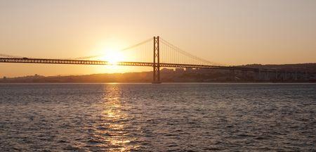 Bridge 25 de Abril on river Tagus at sunset, Lisbon, Portugal