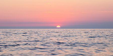 Spectacular sea sunset from the beach of the naturist camping of Cervar Porec (Parenzo), Istria, Croatia