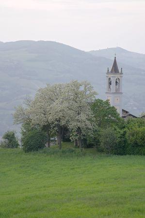Spring in the green countryside of Fellino church, near Travo, Valtrebbia, Italy Stock Photo