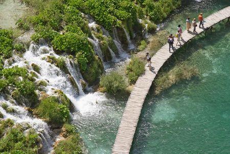 Tourists in Plitvice lake (Plitvicka jezera) natural national park, Croatia
