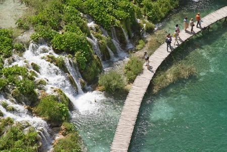 Tourists in Plitvice lake (Plitvicka jezera) natural national park, Croatia