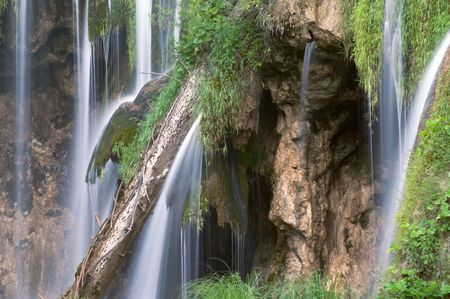 Long exposure image of waterfall and withered trunk in Plitvice lake (Plitvicka jezera) natural national park, Croatia