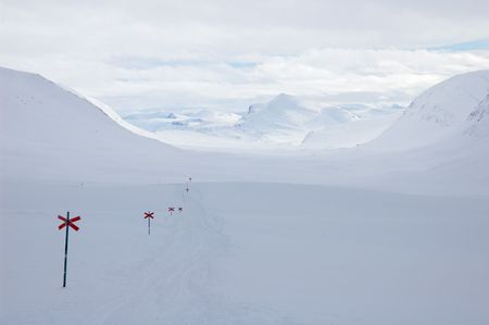 Cross country ski hiking trail Kungsleden with red crosses, Lapland north Sweden