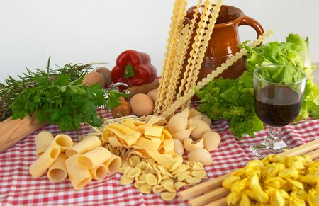 Pasta, vegetables, wine, basic ingredients of Italian and Mediterranean food
