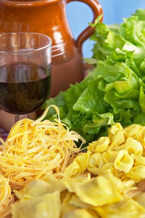 Pasta, vegetables, egg, wine, typical ingredients of Italian and Mediterranean food Stock Photo