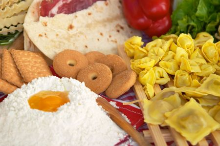 Pasta, egg, flour, biscuits typical ingredients of Italian and Mediterranean food Stock Photo