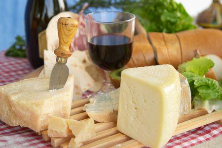 Gorgonzola, parmigiano, pecorino cheese, with wine and bread, typical Italian food, Piacenza