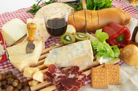 Gorgonzola, parmigiano, pecorino cheese, with wine and bread, typical Italian food, Piacenza