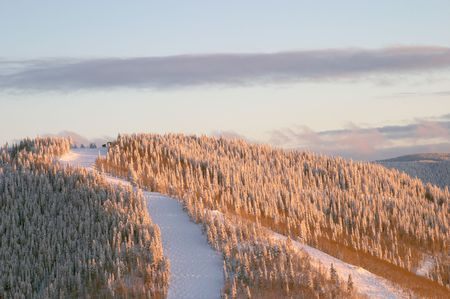 Sunset on ski slopes at winter, Steamboat ski resort, Colorado, United States