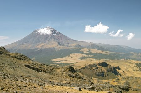 Active snowcapped Popocatepetl volcano (5.452 meters), Mexico from Iztaccihuatl