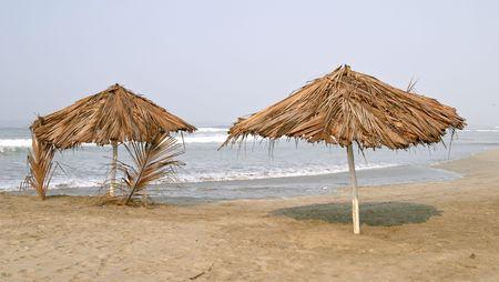 Umbrella and palapa on the beach of Playa Azul, Mexico Stock Photo