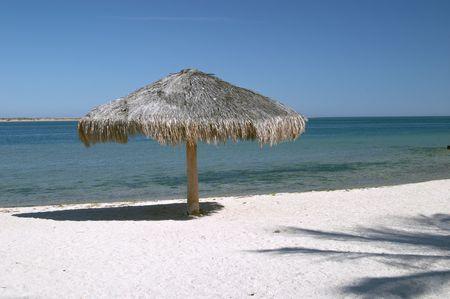 Umbrella on La Paz beach, Baja California, Mexico Stock Photo