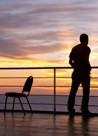 introspection: Man and chair black silhouette and sunset on a ferry