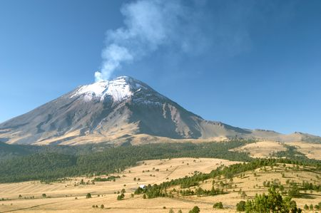 evacuating: Active snowcapped Popocatepetl volcano (5.452 meters), Mexico Stock Photo