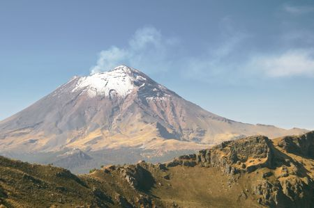 evacuating: Active snowcapped Popocatepetl volcano (5.452 meters), Mexico from Iztaccihuatl