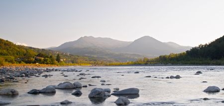 Sunset on Trebbia river Stock Photo