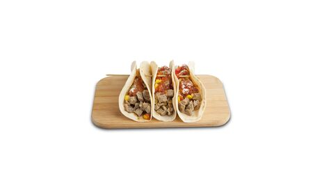 Three Beef tacos on a wooden board isolated on a white background