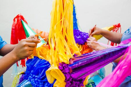 Making a Mexican Pinatas handmade for posadas in Christmas in Mexico Stock Photo