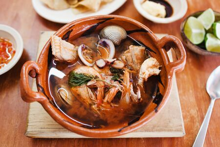 mexican seafood soup, cazuela de mariscos in Mexico is a bowl of spicy food with shrimps and fish Stock Photo