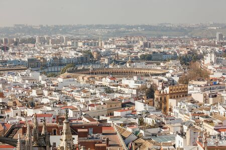 Panorama cityscape aerial view of Seville Spain. Arena of bullfighting in Seville Stock Photo