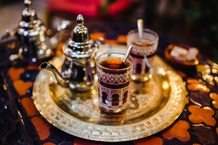 traditional Arabic tea cup, arab people drinking tea in Ramadan