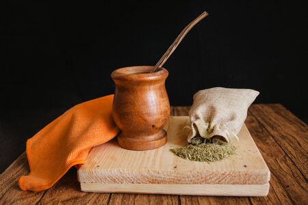 yerba mate tea traditional in Argentina on a black background
