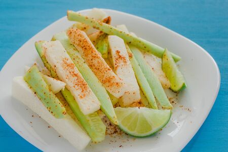 pepinos and jicama con chile, cucumber and jicamas with chili mexican snack spicy food in mexico