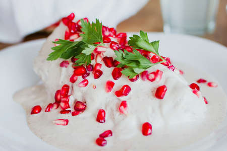 chiles en nogada, traditional Mexican dish with poblano chili peppers and walnut sauce from Puebla Mexico
