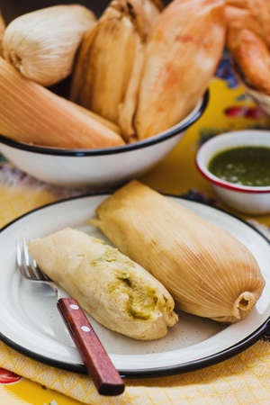 Mexican Tamales green sauce traditional food in Mexico