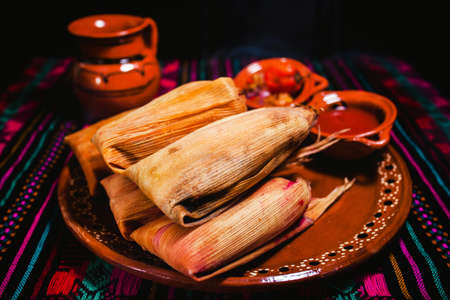 Mexican tamales, mole poblano and red sauce Mexican food in Mexico Фото со стока
