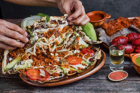 Tlayuda and oaxaca cheese traditional Mexican food from Oaxaca Mexico Фото со стока