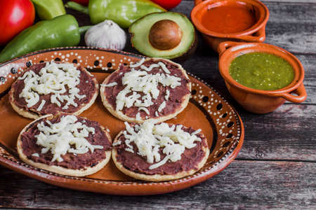 Mexican sopes with grated cheese and fried beans, Traditional breakfast in Mexico