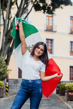 mexican woman at independence day in Mexico holding a flag of mexico Banque d'images
