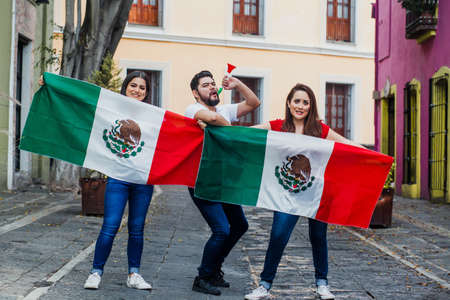 Mexican people with flag in Mexican independence day in Mexico