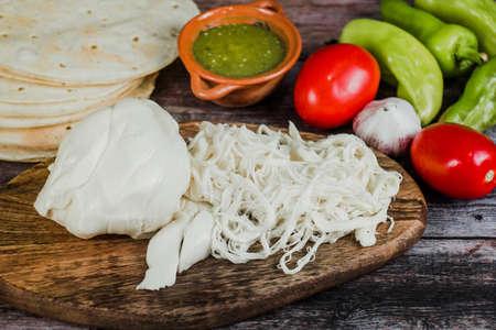 Oaxaca cheese called quesillo traditional from Oaxaca Mexico Фото со стока