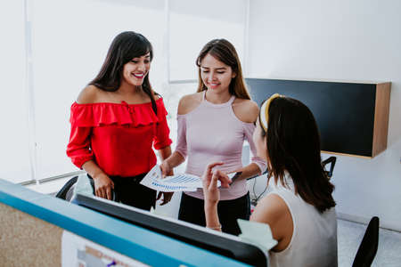 Latin people or office workers using computer and discuss about business project.Teamwork concept in Latin America Фото со стока - 156314652