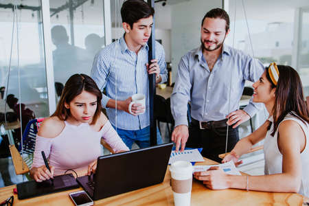 Latin Business teamwork having discussion in a workspace or coworking in Mexico Latin America Фото со стока - 156315162