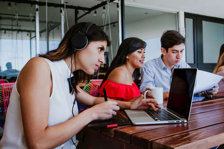 Hispanic University students together with computer or laptop in Mexico Latin America