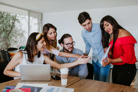 Latin people or office workers using computer and discuss about business project.Teamwork concept in Latin America Фото со стока