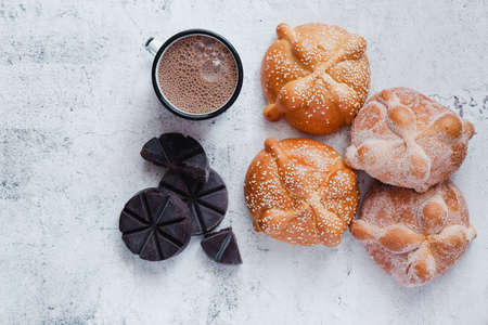 Pan de Muerto and hot chocolate, Mexican bread traditional for day of the Dead in Mexico Фото со стока