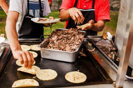 Mexican taquero making Tacos al Pastor in Mexico city
