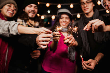 Mexican Posada, group of friends with sparklers in Christmas in Mexico