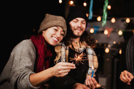 Mexican Posada, group of friends with sparklers in Christmas in Mexico Stock Photo