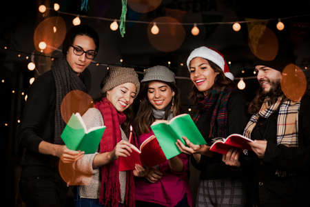 Mexican Posada, latin people at party Singing carols for Christmas in Mexico