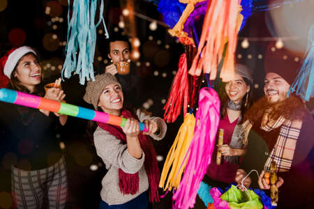 Mexican People breaking a piñata celebrating a Posada in Christmas Mexico Stock Photo