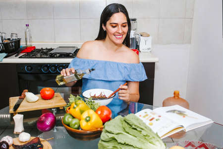 Latin woman cooking healthy food in a mexican kitchen in Mexico city