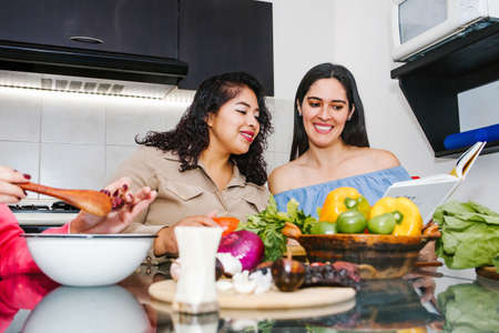latin women cooking vegetables food and having fun in a mexican kitchen in Mexico city