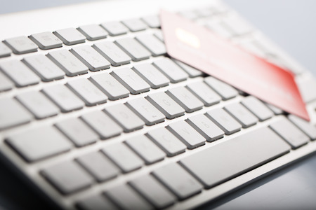 Macro of a credit cards on a computer keyboard. photo